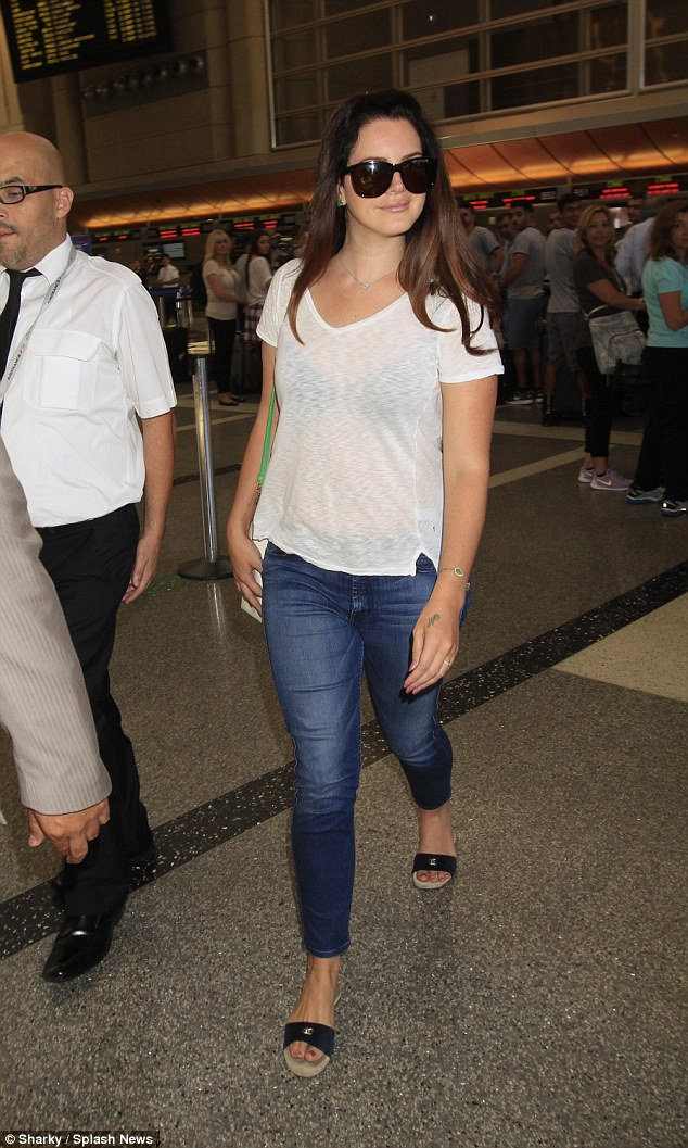 Born to fly: Lana Del Rey and boyfriend Francesco Carrozzini jetted out of LAX on Thursday.