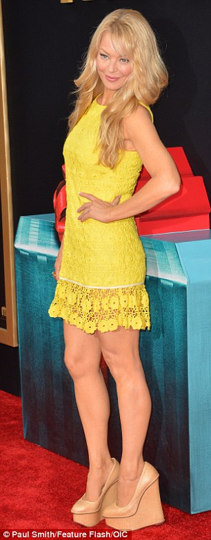 Sunny:Charlotte Ross brightened up the carpet in a crochet yellow dress which she teamed with a pair of tan wedge heels