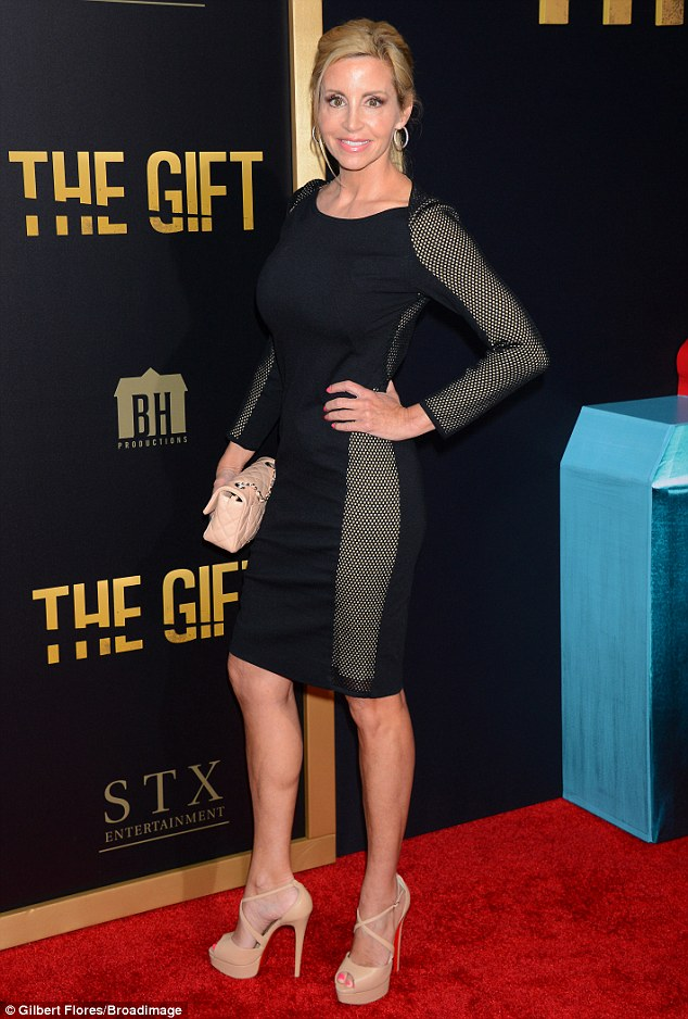 Her time to shine! Camille Grammer showed off her toned figure in a fitted black dress as she attended The Gift film premiere in Los Angeles, California on Thursday