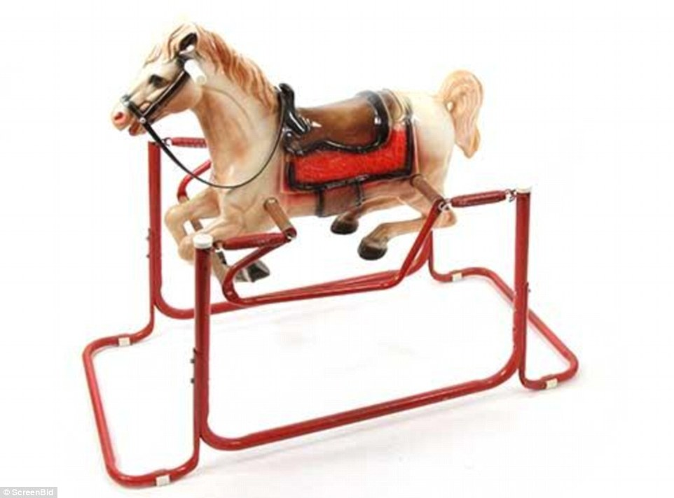 The wooden and metal toy, reminiscent of the 1960s, is engraved and still swings. It has a starting price of $50