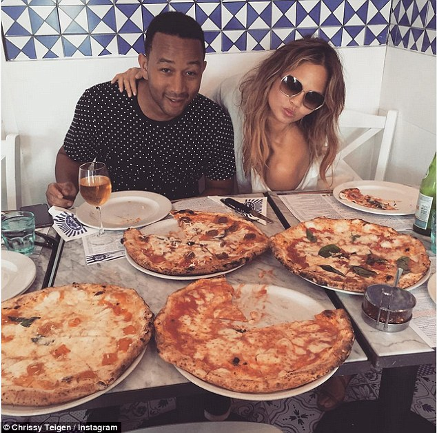 Tucking in: The couple have recently been in Europe and enjoyed a pizza feast in Naples