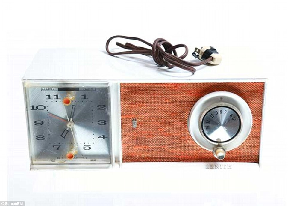 The working clock radio, made by Zenith, has an orange fabric pattern on the speaker. It starts at $50