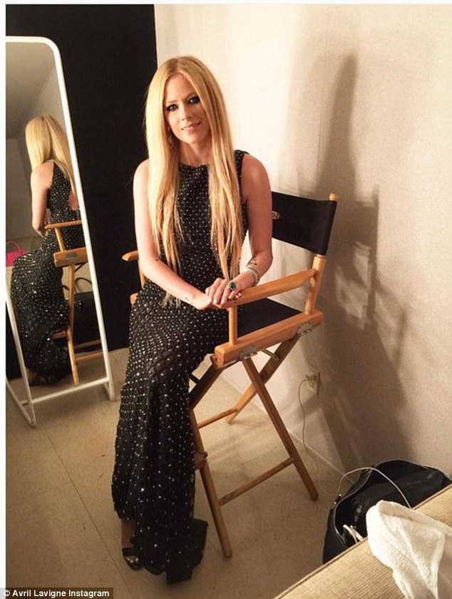 Game-face: She also shared this elegant portrait of her camera-ready and calmly seated backstage at the event