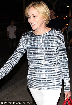 Blonde beauty: The Basic Instinct star showed her blonde pixie haircut upon her arrival