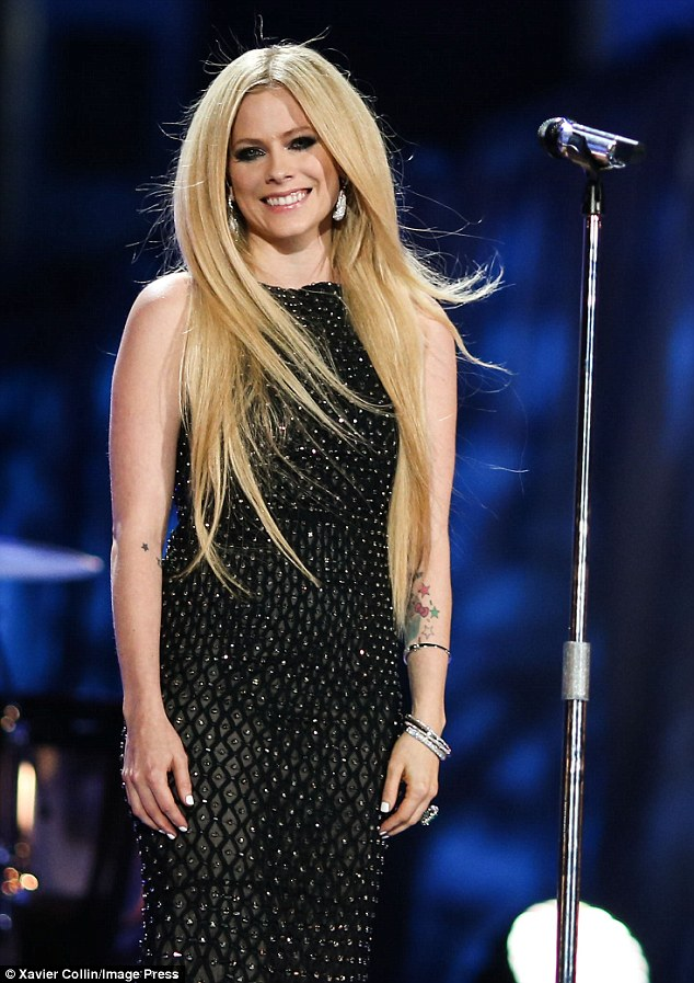 Revitalized: The blonde beauty wore a floor-length gown with silver studs at the Memorial Coliseum in Los Angeles