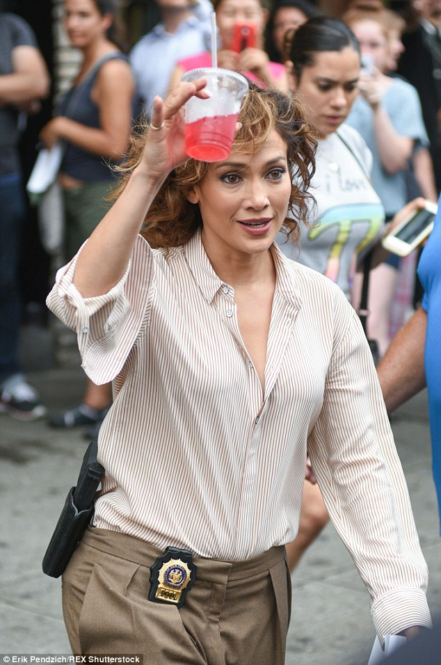 Hey you! As cameras rolled the star was filmed walking out from a crowded sidewalk while trying to get someone's attention with a bright red drink in her hand