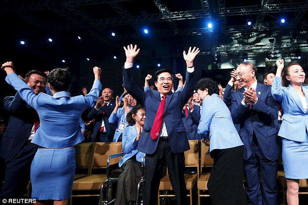 Beijing's Mayor and president of the bid delegation Wang Anshun (centre) celebrates the decision