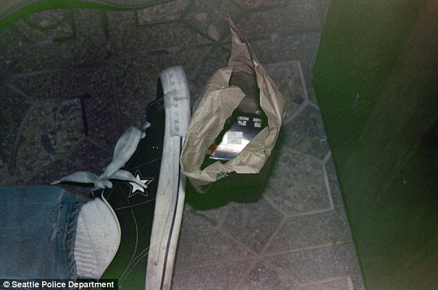 Suicide? Abox of shotgun shells lie next to Kurt Cobain's foot in a picture released 20 years after his death. Richard Lee now wants all the scene photos to be released