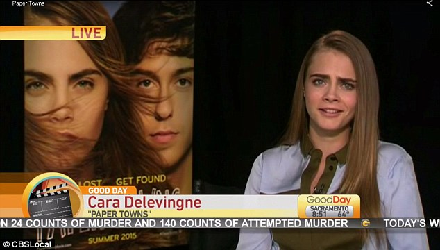 Infamous: Supermodel Cara Delevingne  during the 'awkward' interview on Good Day Sacramento, in which the anchors introduced her as 'Carla' before asking her whether she had read John Green's Paper Towns