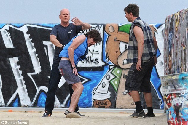 Action star: Bruce Willis displays his tough side as he filmed in Venice Beach, California earlier this month