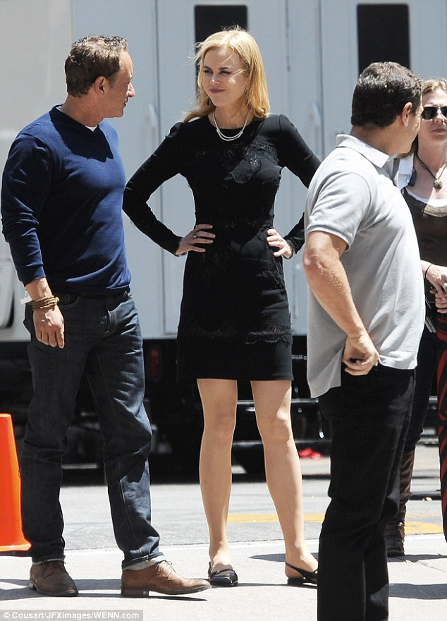 High spirits: Nicole appeared in high spirits, laughing and joking with the crew between takes