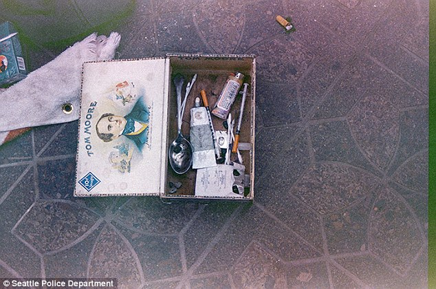 Addict: A box on the floor was filled with a spoon and needles, consistent with drug abuse