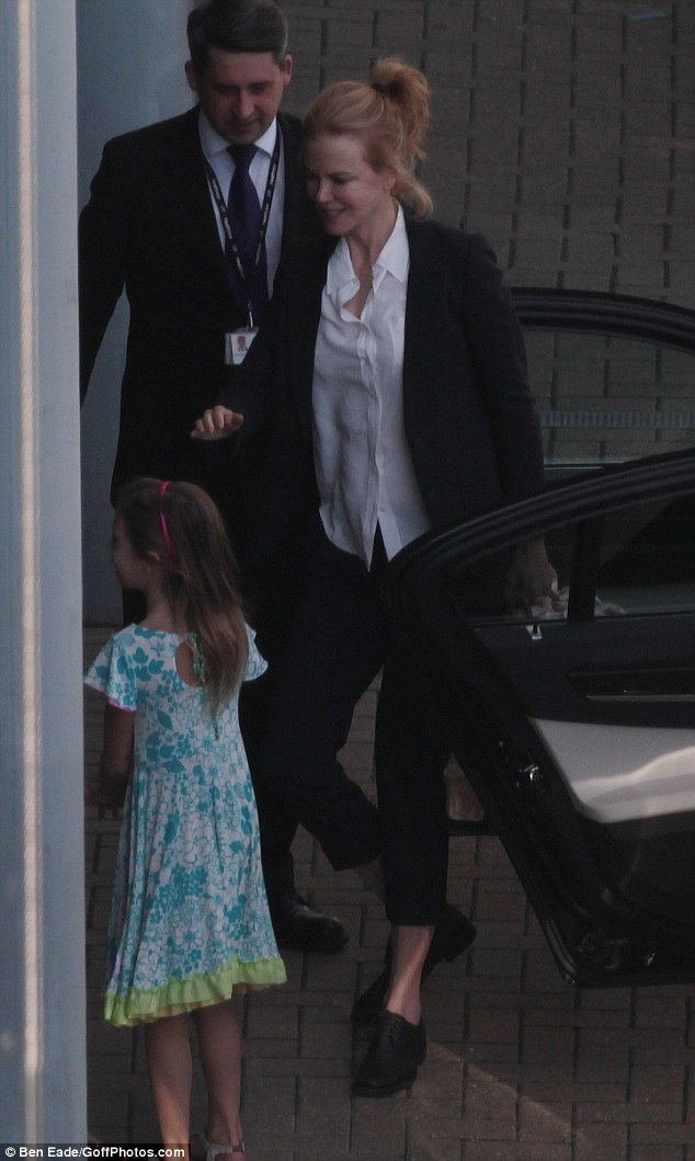 Stylish arrival: Nicole Kidman was spotted arriving at Heathrow Airport in London on Thursday evening with her daughtersSunday Rose, seven, (pictured) and four-year-old Faith