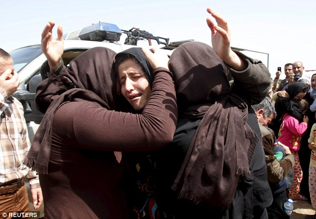 Joy: Bohar is one of hundreds of Yazidis who have managed to escape, like these women, pictured in April