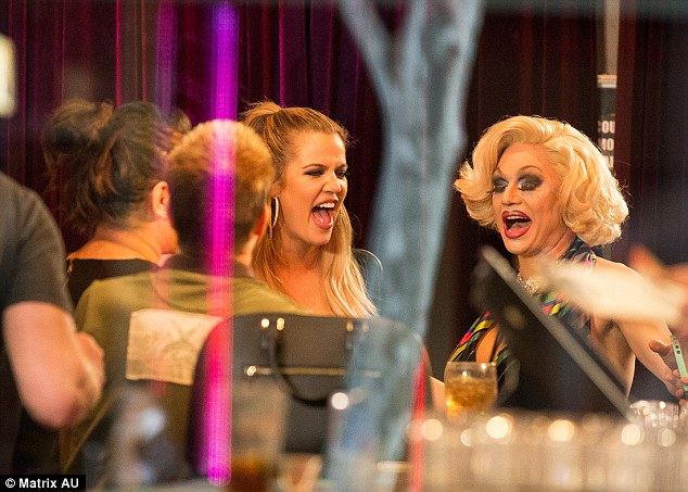 Good times! Khloe Kardashianwas seen sharing a laugh with a fabulously dolled up transgender performer at Sydney's Stonewall Hotel on Friday