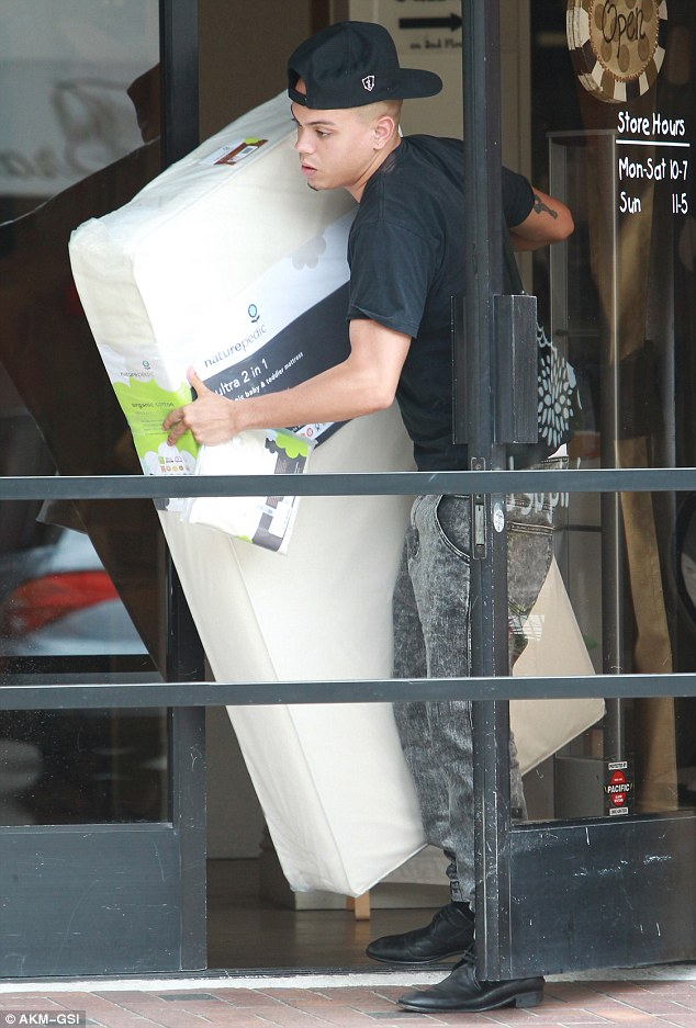 Preparation: Ross picked up a baby mattress while at the high-end baby supply store