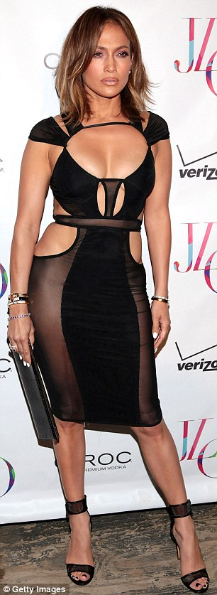 A body to admire: The artist showed off an enviable figure in a sheer black dress