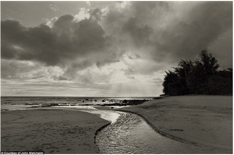 Heavenly: Sun breaks through the clouds on the Ke'e Beach, where the community was located from 1969 until 1977