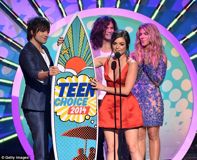Pretty win: Lucy Hale is shown at the 2014 Teen Choice Awards as the Pretty Little Liars star accepted a surfboard award
