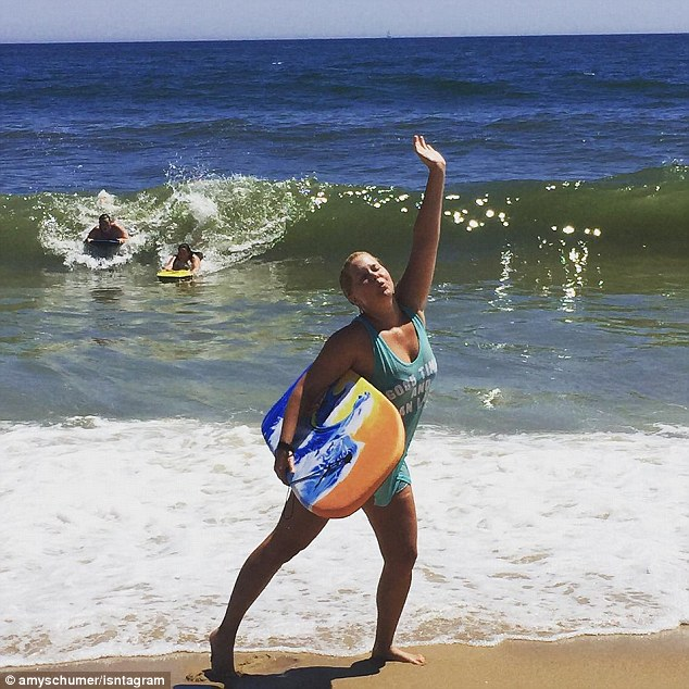 Fun in the sun: Amy put some photos of her vacation on her Instagram account, including one photo of herself posing with a boogie board in front of a seaside backdrop on Friday