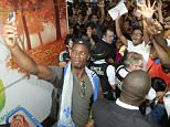 Montreal Impact's new soccer player Didier Drogba, left, takes a photo with fans as he arrives at Pierre Elliott Trudeau International Airport in Montreal, Wednesday, July 29, 2015. (Ryan Remiorz/The Canadian Press via AP) MANDATORY CREDIT
