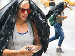 EXCLUSIVE: Lily Allen Spotted Checking For The Weather On Her iPhone While Walking Through A Major Thunderstorm While Out In New York City on Thursday afternoon Jul 30, 2015  Pictured: Lily Allen Ref: SPL1091161  300715   EXCLUSIVE Picture by: Felipe Ramales / Splash News  Splash News and Pictures Los Angeles: 310-821-2666 New York: 212-619-2666 London: 870-934-2666 photodesk@splashnews.com