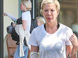 30.JULY.2015 - LOS ANGELES - USA\n*** EXCLUSIVE ALL ROUND PICTURES ***\nTORI SPELLING IS SEEN MAKE UP FREE WITH HER DAUGHTER AS SHE STOPS AT RITE AID PHARMACY BEFORE HEADING TO THE DAILY SPA IN CALABASAS.\nTORI HAS HER ARM IN A BANDAGE AFTER SUFFERING SERVERE BURNS FROM FALLING ON A HOT GRILL IN A RESTAURANT 4 MONTHS AGO.\nBYLINE MUST READ : XPOSUREPHOTOS.COM\n***UK CLIENTS - PICTURES CONTAINING CHILDREN PLEASE PIXELATE FACE PRIOR TO PUBLICATION ***\n**UK CLIENTS MUST CALL PRIOR TO TV OR ONLINE USAGE PLEASE TELEPHONE  44 208 344 2007 ***