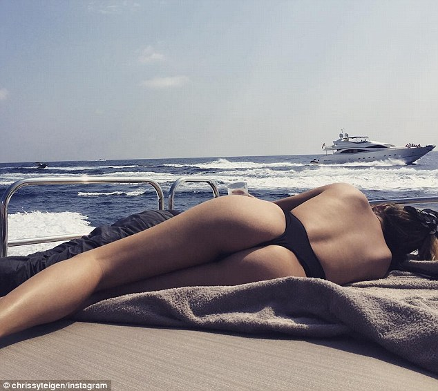 All of me: Nina's fellow Sports Illustrated model Chrissy Teigen showed off her nearly naked and perfectly pert posterior on Instagram last month, too