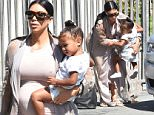 A pregnant Kim Kardashian takes daughter North West to a dance class in Los Angeles\n\nPictured: Kim Kardashian And Daughter North West\nRef: SPL1092516  020815  \nPicture by: Photographer Group / Splash News\n\nSplash News and Pictures\nLos Angeles: 310-821-2666\nNew York: 212-619-2666\nLondon: 870-934-2666\nphotodesk@splashnews.com\n