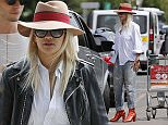 Picture Shows: Rita Ora  August 01, 2015\n \n **MINIMUM WEB AND PRINT USAGE £250**\n \n Rita Ora, British pop singer and judge on the latest series of 'The X Factor', is seen arriving at the airport in Essex, England.\n \n The twenty-four year-old, who has recently split up with boyfriend Ricky Hil, was casually dressed in a brown fedora, sunglasses, a loose-fitting white blouse, \n paint-splattered denim jeans and eye-catching red ankle boots.\n \n **MINIMUM WEB AND PRINT USAGE £250**\n \n Exclusive  All Rounder \n WORLDWIDE RIGHTS\n \n Pictures by : FameFlynet UK © 2015\n Tel : +44 (0)20 3551 5049\n Email : info@fameflynet.uk.com