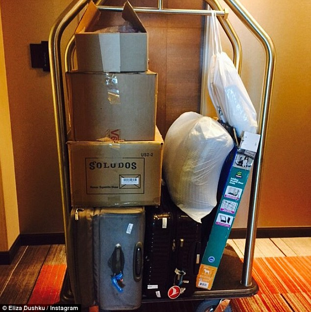 Oh no! Dushku Instagrammed a photo of her packed and boxed-up items, which sat on a golden luggage cart