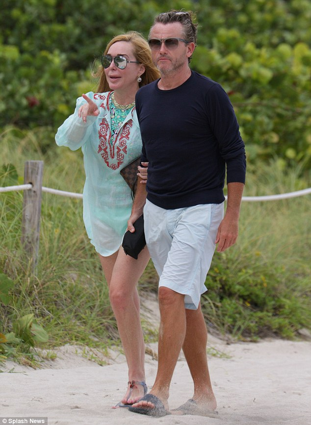 On a stroll: The couple left the beach arm-in-arm. There is still no word from Bravo on whether it will renew The Real Housewives Of Miami after its third season ended in November 2013