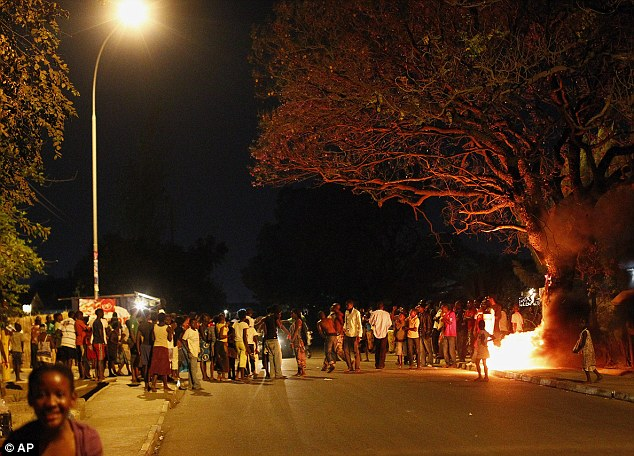 Mr Sata's supporters celebrate him finally winning an election at the third attempt
