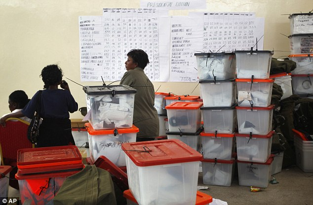 Election volunteers prepare for the ballot count, in which Mr Sata won 43 per cent of the vote