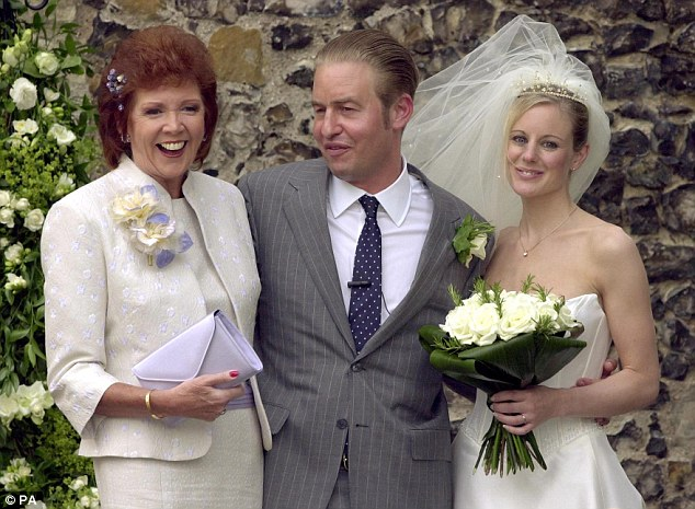 Cilla Black is pictured with son Robert Willis and his new wife Fiona after their wedding at St Mary The Virgin Church in Denham, Buckinghamshire in August, 2001