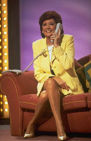 Cilla Black on the phone in Surprise Surprise in 1997