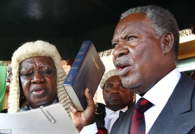 Rise to power: Mr Sata's swearing-in yesterday