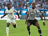 Juventus' French midfielder Paul Pogba (R) vies for the ball with Marseille's Ivorian defender Brice Dja Djedje during  the Robert Louis-Dreyfus Trophy football friendly match Olympique de Marseille vs Juventus on August 1, 2015 at the Velodrome stadium in Marseille, southeastern France. AFP PHOTO / BERTRAND LANGLOISBERTRAND LANGLOIS/AFP/Getty Images