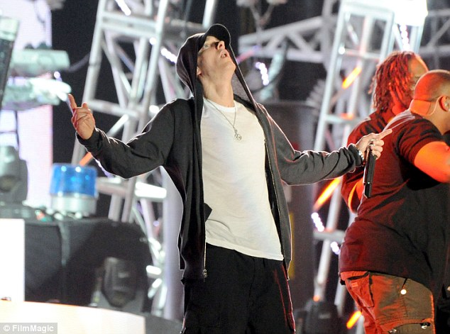 Best-selling artist: 'I know a lot of these DVD guys are wacky, but I'm alone in my gym; I need someone on the TV yelling to motivate me. Besides, some of this s*** is entertaining,' the world-famous rapper writes in the Men's Journal article. Above,Eminem performs at Coachella Festival in Indio, California, in April 2012