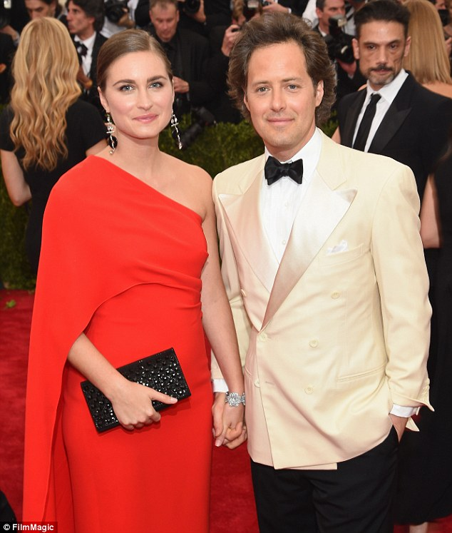 Red carpet regulars: Lauren looked stunning in red when she and David attended the Met Gala in May