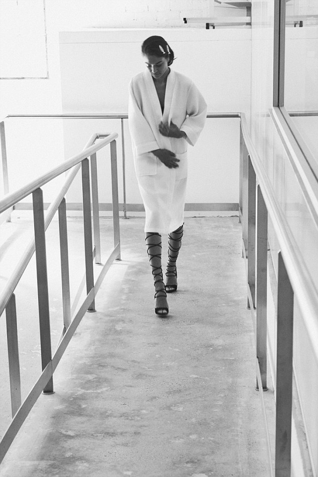 Preparation: Shanina is seen in one particularly BTS moment arriving to the set in a white robe and sassy wrap heels