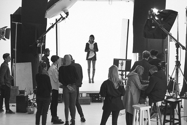 Team effort! A team of makeup artists, stylists, lighting and shooting personnel gather around set, making sure the magic happens properly