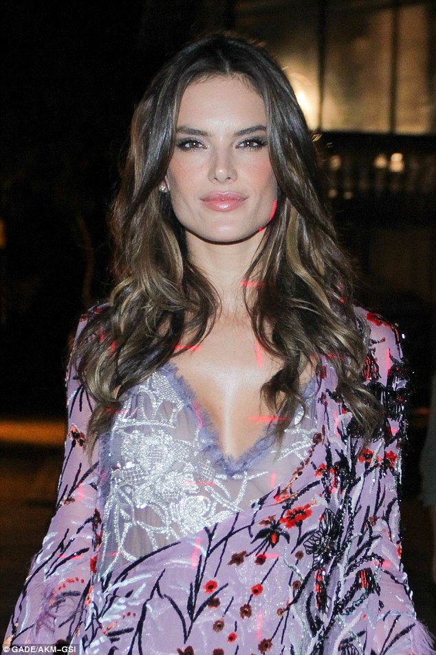 Stunner: The 34-year-old actress looked stunning in a lavender long sleeve adorned with orange flowers and tree branches