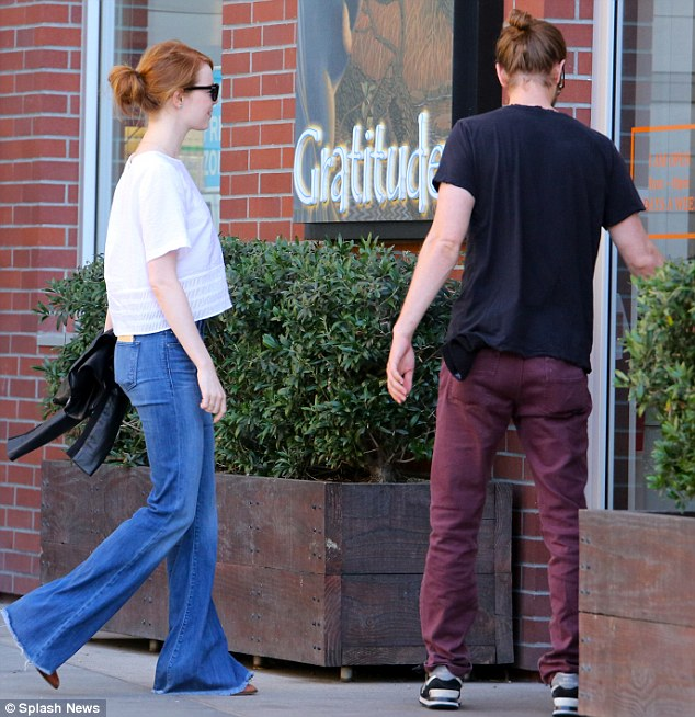 Relaxed: British actor Andrew, 31, rocked a black T-shirt, burgundy trousers, New Balance trainers and had his long brown tresses pulled back in an on-trend manbun