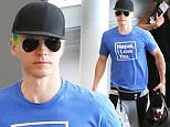 """Actor, Jared Leto catches a departing flight at the Airport in Toronto, Canada. Jared Leto was showing off his Green Hair and Tattoos as he's been in Toronto filming the movie """"Suicide Squad"""", where he's playing the role of """"The Joker"""". Jared was also dressed very casual wearing a black baseball cap, aviator sunglasses, a blue Napal I Love You t-shirt, a Black Thirty Seconds To Mars Fanny Pack, grey sweatpants, multi-coloured striped socks, Vans running shoes, while carrying a black duffel bag with food inside. \n\nPictured: Jared Leto\nRef: SPL1092263  010815  \nPicture by: S Fernandez / Splash News\n\nSplash News and Pictures\nLos Angeles: 310-821-2666\nNew York: 212-619-2666\nLondon: 870-934-2666\nphotodesk@splashnews.com\n"""
