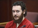James Holmes sits in court for an advisement hearing at the Arapahoe County Justice Center in Centennial, Colorado in this June 4, 2013 file photo. Jurors in the Colorado movie massacre trial reached a verdict on August 3, 2015 on whether mitigating factors such as mental illness count for more than aggravating ones that could justify execution for the gunman, James Holmes, the judge said.  REUTERS/Andy Cross/Pool/Files