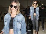 Gigi Hadid arrives in Sydney showing a bit of skin\n\nPictured: GIGI HADID\nRef: SPL1093469  030815  \nPicture by: MAD MAX PEPITO / Splash News\n\nSplash News and Pictures\nLos Angeles: 310-821-2666\nNew York: 212-619-2666\nLondon: 870-934-2666\nphotodesk@splashnews.com\n