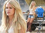*EXCLUSIVE* Mojave Desert, CA - Carrie Underwood braves the California heat and spends the day in the Desert filming her next Video, she displayed her sexy figure wearing a white top with Daisy Dukes and knee high brown fringe boots. Carrie Underwoodës comeback to country after giving birth to baby Isaiah Michael Fisher has been a very successful one, and it just keeps getting better. The proud mama sold out four shows at the Grand Ole Opry in just one weekend.\nAKM-GSI      August 02, 2015\nTo License These Photos, Please Contact :\nSteve Ginsburg\n(310) 505-8447\n(323) 423-9397\nsteve@akmgsi.com\nsales@akmgsi.com\nor\nMaria Buda\n(917) 242-1505\nmbuda@akmgsi.com\nginsburgspalyinc@gmail.com