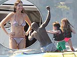 26.JULY.2015 - POSITANO - ITALY\n*** EXCLUSIVE ALL ROUND PICTURES ***\n***STRICTLY AVAILABLE FOR UK, GERMANY USA AND AUSTRALIA USE ONLY***\nMUSICIAN HENRY OLUSEGUN ADEOLA SAMUEL AKA SEAL PICTURED HAVING FUN WITH FRIENDS WHILE ENJOYING HIS SUMMER HOLIDAY IN POSITANO, ITALY!\nBYLINE MUST READ : XPOSUREPHOTOS.COM\n***UK CLIENTS - PICTURES CONTAINING CHILDREN PLEASE PIXELATE FACE PRIOR TO PUBLICATION ***\n**UK CLIENTS MUST CALL PRIOR TO TV OR ONLINE USAGE PLEASE TELEPHONE 44 208 370 0291**