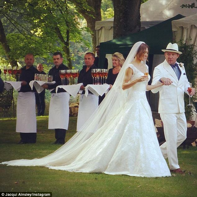 Here comes the bride: Jacqui looked stunning in hercouture wedding dress by designer Phillipa Lepley, as her new husband walked her through their home